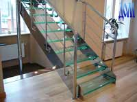 Direct metal staircase on the string with glass stairs