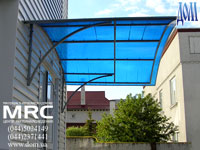 Porte-cochere from tinted light absorpsion polycarbonate