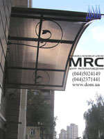 Porte-cochere. Metalic construction from black metal in powder-like paiting cover of varnish