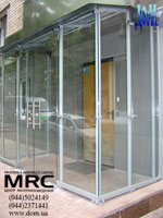 Pendulum glass door and glass walls as a part of glass entrance lobby