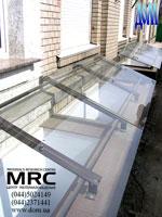 Cascade of glass porte-cochere
