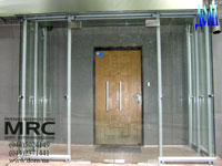 Glass entrance lobby produced from back metal and tempered glass