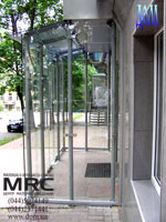 Glass entrance lobby consists metalic framework, glass door and glass walls